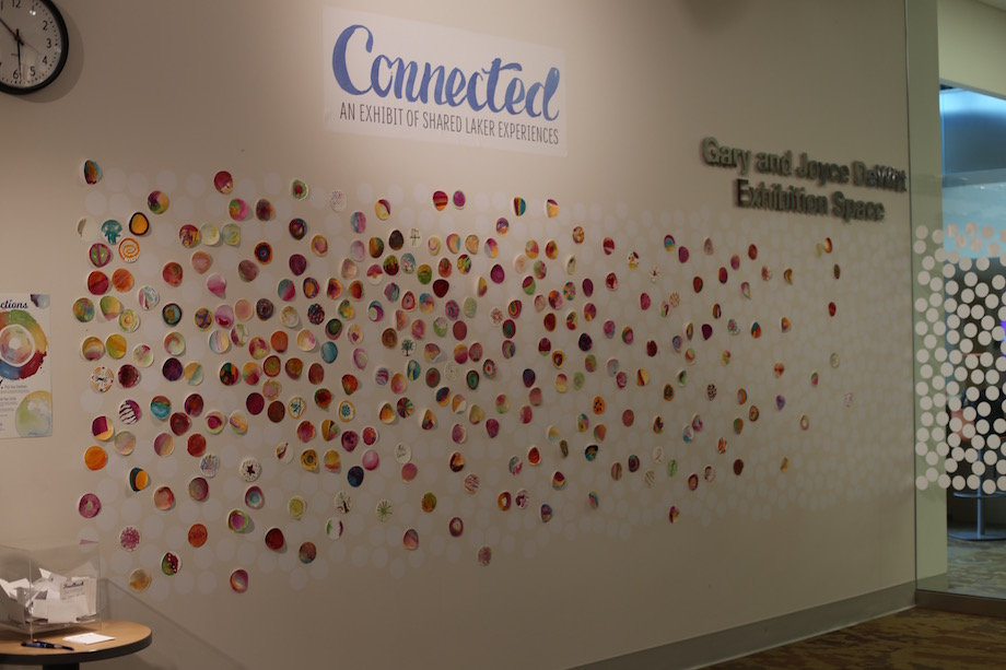 A wall of the Connected exhibit included paper dots that participants painted with watercolors to portray their emotions.