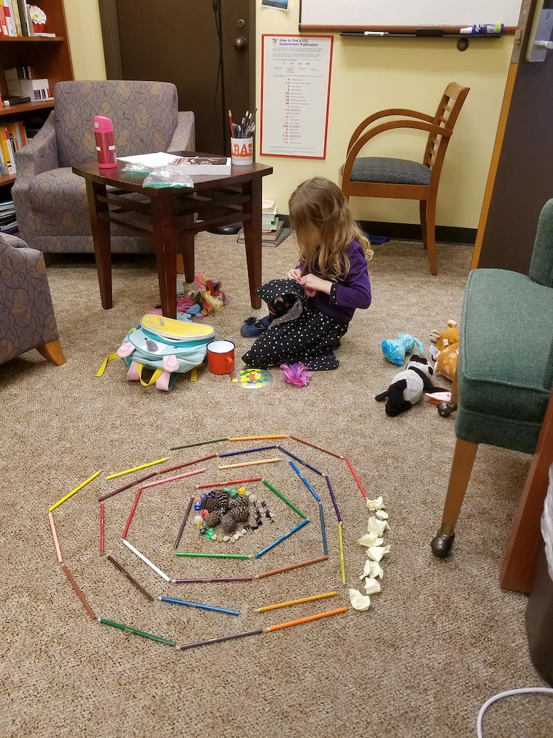 Author's daughter playing in her library