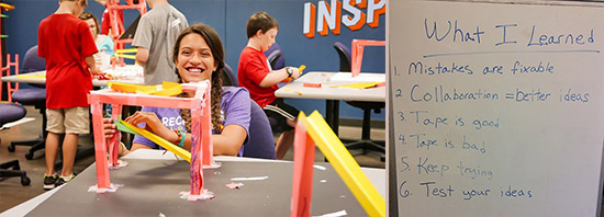 Participant smiling while making a structure